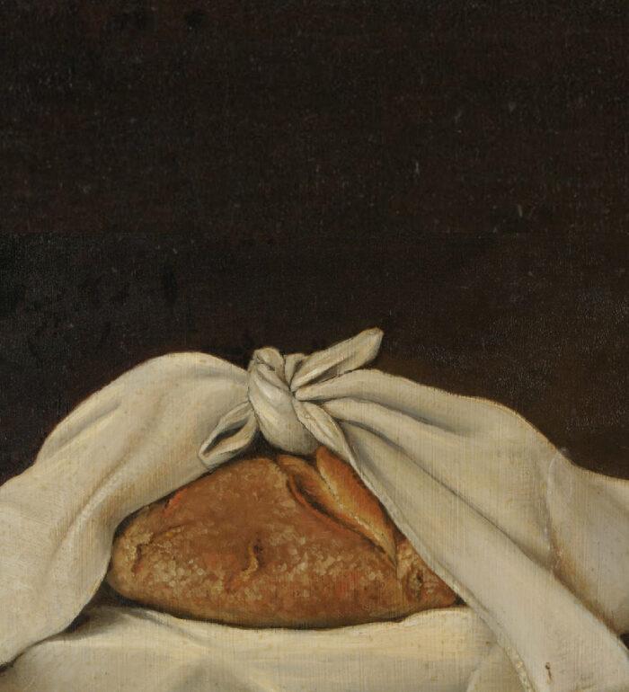 Obraz przedstawiający chleb zawinięty w chustę